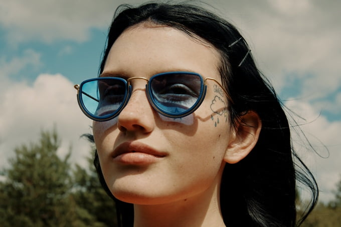 A woman showcasing Forever Wires, an eyewear collection made from plants.